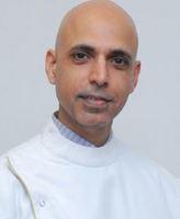 Dr. Burzin Khan - Prosthodontics, Implantology